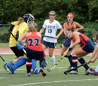 Neshaminy's Mia Sexton (#4) and Elayno Curtin (22) pressure CR North goalie Margaret D'Auria.