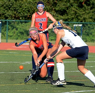 Neshaminy's Elana Donato (15) clears ball by Council Rock South's Paige Schmid (12) in field hockey matchup between the schools Sept. 23 at Walt Snyder Stadium. (John Gleeson – 21st-Century Media)