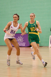 Katy Rose of Loughborough Lightning chases Renae Hallinan of the Australian Diamonds during the first of three friendly matches against Loughborough Lightning in a taster of the new Fastnet 2020 style netball rules. Matches played at Loughborough University on the 7th October 2009.