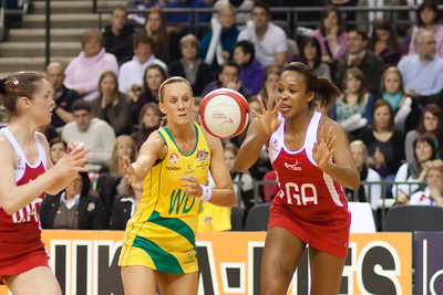 Pamela Cookey of England Netball passes to fellow team mate Karen Atkinson goes for the shot during the 1st International Netball Test between England & Australia at the Echo Arena in Liverpool on 19th February 2010
