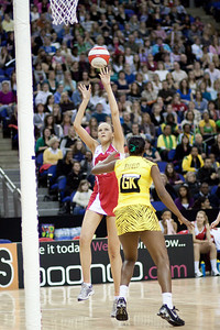 Jo Harten goes for the shot against Althea Byfield during the 1st of 3 Test matches between England Netball and Jamaica's 'Sunshine Girls'. Played at the o2 Arena in London