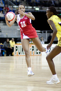 Pamela Cookey in flight during the 1st of 3 Test matches between England Netball and Jamaica's 'Sunshine Girls'. Played at the o2 Arena in London.