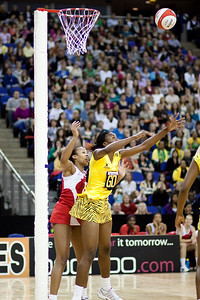Pam Cookey of England Netball looking for the ball during the 1st of 3 Test matches between England Netball and Jamaica's 'Sunshine Girls'. Played at the o2 Arena in London.