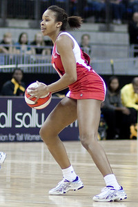Pamela Cookey of England Netball, ready to pass the ball during the 1st of 3 Test matches between England Netball and Jamaica's 'Sunshine Girls'. Played at the o2 Arena in London.