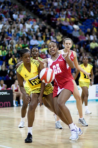 Pamela Cookey collides with a fellow player during the 1st of 3 Test matches between England Netball and Jamaica's 'Sunshine Girls'. Played at the o2 Arena in London.
