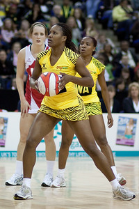 Sara Bayman looks on as a Jamaican player eyes up her shot during the 1st of 3 Test matches between England Netball and Jamaica's 'Sunshine Girls'. Played at the o2 Arena in London.
