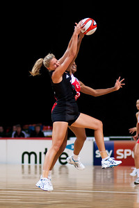 Pamela Cookey of England Netball and Casey Williams of the Silver Ferns in action during the 1st of 3 matches as part of the FIAT International Netball Test Series between England & New Zealand at the MEN Arena, Manchester on 15th January 2011.
