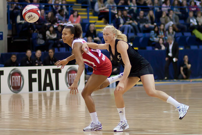Serena Guthrie of England Netball & Laura Langman of New Zealand in action during the 2nd of 3 matches as part of the FIAT International Netball Test Series between England & New Zealand at the Capital FM Arena, Nottingham on 17th January 2011