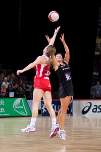 Sara Bayman of England Netball and Anna Thompsonof the Silver Ferns in action during the 1st of 3 matches as part of the FIAT International Netball Test Series between England & New Zealand at the MEN Arena, Manchester on 15th January 2011.