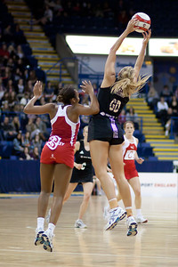 Pamela Cookey of England Netball & Casey Williams of New Zealand in action during the 2nd of 3 matches as part of the FIAT International Netball Test Series between England & New Zealand at the Capital FM Arena, Nottingham on 17th January 2011