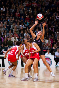 Tamsin Greenway, Serina Guthrie and Pamela Cookey of England Netball and Anna Scarlet of the Silver Ferns in action during the 1st of 3 matches as part of the FIAT International Netball Test Series between England & New Zealand at the MEN Arena, Manchester on 15th January 2011.