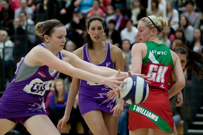 Lianne Badmin and Stephanie Williams look on as Jo Harten grabs the ball during the Cooperative Netball Superleage match between Loughborough Lightning and Celtic Dragons played at Walsall Campus on 6th February 2010