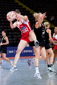 Karen Atkinson of the England Netball Team in action against the New Zealand Silver Ferns in game four of the World Netball Series from the MEN arena in Manchester, England, October 2009