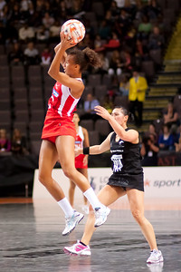 Serena Guthrie of the England Netball Team in action against the New Zealand Silver Ferns in game four of the World Netball Series from the MEN arena in Manchester, England, October 2009