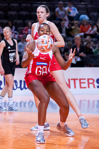 Pamela Cookey and Jo Harten of the England Netball Team in action against the New Zealand Silver Ferns in game four of the World Netball Series from the MEN arena in Manchester, England, October 2009