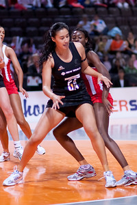 Maria Tutaia of the New Zealand Silver Ferns in action against England Netball in game four of the World Netball Series from the MEN arena in Manchester, England, October 2009