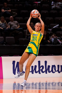 Lauren Nourse of the Australian Diamonds in action from game Six of the World Netball Series, Twenty20 style netball between Malawi v Australian Diamonds Netball team, from the MEN arena in Manchester, England, October 2009