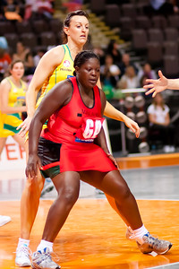 Mary Waya of the Malawi Netball team in action from game Six of the World Netball Series, Twenty20 style netball between Malawi v Australian Diamonds Netball team, from the MEN arena in Manchester, England, October 2009