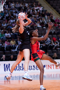 Irene Van Dyk of the New Zealand Silver Ferns Netball Team in action against Malawi in game three of the World Netball Series from the MEN arena in Manchester, England, October 2009