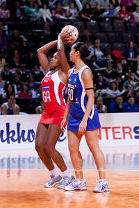Pamela Cookey of England Netball goes for the shot during game one of the World Netball Series, England Netball v Samoa. October 2009 at the MEN arena in Manchester, England