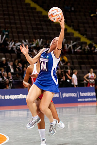 Samantha Lewis of the Samoa Netball team in action during game one of the World Netball Series, England Netball v Samoa. October 2009 at the MEN arena in Manchester, England.