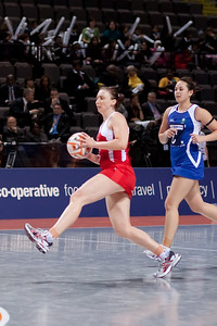 Jade Clarke of England Netball in action during game one of the World Netball Series, England Netball v Samoa. October 2009 at the MEN arena in Manchester, England.