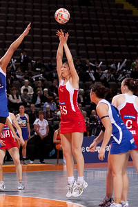 Rachel Dunn of England Netball scores the 1st ever 4 point goal during game one of the World Netball Series, England Netball v Samoa. October 2009 at the MEN arena in Manchester, England.
