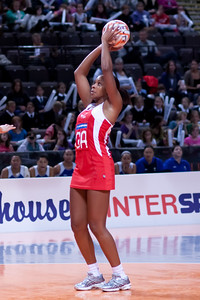 Pamela Cookey of England Netball goes for the shot during game one of the World Netball Series, England Netball v Samoa. October 2009 at the MEN arena in Manchester, England.