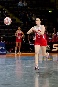Jade Clarke of England Netball takes the shot during game one of the World Netball Series, England Netball v Samoa. October 2009 at the MEN arena in Manchester, England.