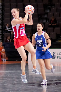 Karen Atkinson of England Netball in action during game one of the World Netball Series, England Netball v Samoa. October 2009 at the MEN arena in Manchester, England.