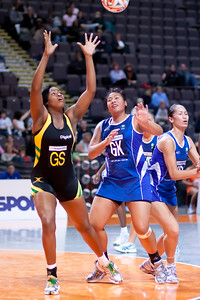 Romelda Aiken of the Jamaican Sunshine Girls in action during game five of the World Netball Series, Twenty20 style netball between Samoa v Jamaica's Sunshine Girls Netball team, from the MEN arena in Manchester, England, October 2009