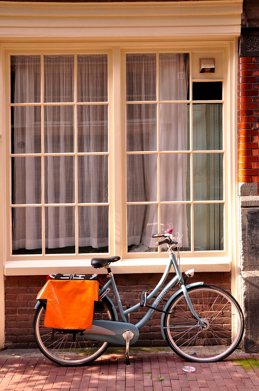 A bicycle in front of window, Amsterdam, Netherlands