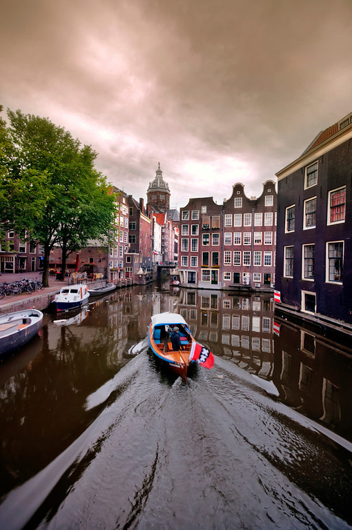 Boat sailing in canal, Amsterdam