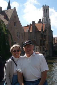 Pat, Jerry and Bruges medieval buildings along the River Dijver.