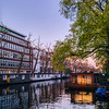 Houseboats on a canal in the city of Amsterdam.
