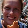 Emilie tasting a stroopwafel (syrup waffle)