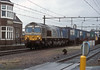 ERS 6604 passes the station at Gilze-Rijen with another train from Italy to Rotterdam docks on 6 February 2008