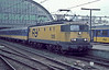 NS 1305 is seen leaving Amsterdam Central on 3 November 1993