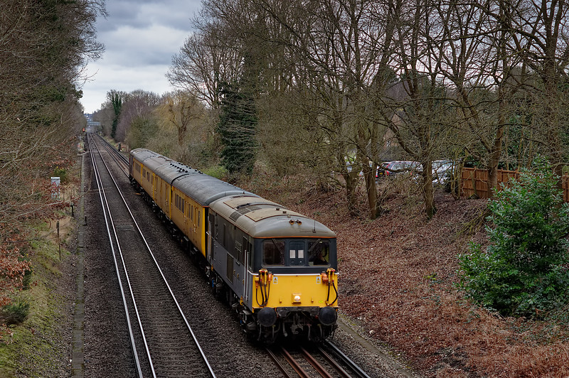 73128 top & tailed with 73136 on 1Q82, the 05:20 Hither Green - Woking. <br /> Shown at Whitmoor Common, near Guildford on 24th February 2015.