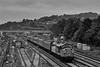 """37057 """"Barbara Arbon"""" top & tail with DBSO 9708, departs from Guildford with 3Z44, <br /> the 07:07 London Bridge - Woking Up Yard Reception, on 18th September 2021. Processed in black & white to reduce the impact of the bright red buffer stop, in the miidle of the picture."""