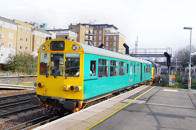 Inspection Saloon 975025 arrives into Kensington Olympia, being propelled by 37409 on the: 2Z01 09:00 Willesden to Willesden Circular 15/03/11