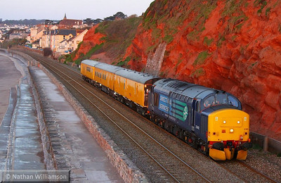 37402 heads north along the Dawlish Sea Wall passing Rockstone Bridge at 05:58am, just minutes after sunrise on the: 3Q54 22:47 Riverside to Riverside via Lostwithiel 01/05/13  Watch the video at: http://youtu.be/Y_QmD2rOwTQ