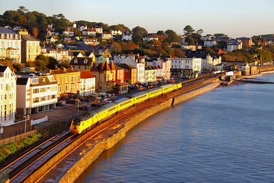 43062 heads south along the Dawlish Sea Wall passing Marine Parade, in the early Autumn sunshine on the: 1Q18 05:17 Old Oak Common to Plymouth 28/10/11