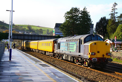 37602 heads west through Totnes on the rear of a Network Rail Radio Survey Train in the winter sunshine working the: 1Q13 06:00 Derby RTC to Laira 05/12/11  Watch the video at: http://youtu.be/TMfv4_rIDRA