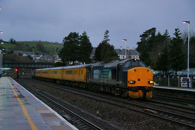 37606 heads north through Totnes before dawn with a Network Rail Radio Survey Train forming the: 1Q13 07:33 Laira to Cambridge TMD  07/12/11