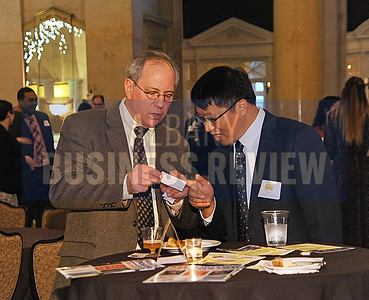 4-2-2015, Dave Bartley of Carousel Industries learns to pronounce the name of Xu Xie from the China Trade & Business Representative Office at ABR's Hoppy Hour.
