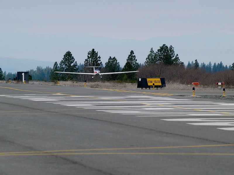 3039807 Rand about to touch down at Nevada County Airport, up the hill from Brunswick Basin.
