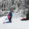Gen gets Grace ready for a tush slide while Luke waits for his sled ride into Manzanita Hill Garden.