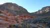 Heading up to the saddle.  The beautiful striped red rocks are petrified sand dunes.