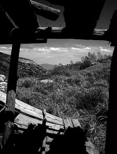 Ruby Hill, NV or Rubyville, NV Schell Creek Range. This photo is taken from inside the historic cabins prior to their stabilization.